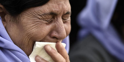 HANOVER, GERMANY - AUGUST 16:  A woman cries over the loss of her daughter during a protest of ethnic Yazidis against the ongoing attacks against Yazidi in northern Iraq on August 16, 2014 in Hanover, Germany. Tens of thousands of Yazidi, who practice their own religion and are neither Christian nor Muslim, have fled targeted violence from ISIS Muslim Sunni fighters in the region of northern Iraq that borders Syria and Kurdish regions. An estimated 90,000 Yazidi live in Germany, more than in any other country in Europe.   According to offical police sources, more than 10.000 demonstraters participated in the rally.  (Photo by Alexander Koerner/Getty Images)