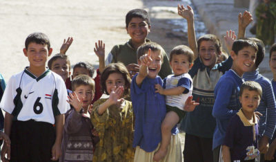 Iraqi children in the Nineveh Province wave to troops liberating them from ISIS (Photo: Akram Saleh /Getty Images)