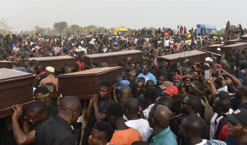 Pallbearers in Nigeria carry coffins of Christians killed by Muslim Fulani herdsmen (Photo: PIUS UTOMI EKPEI/AFP/Getty Images)
